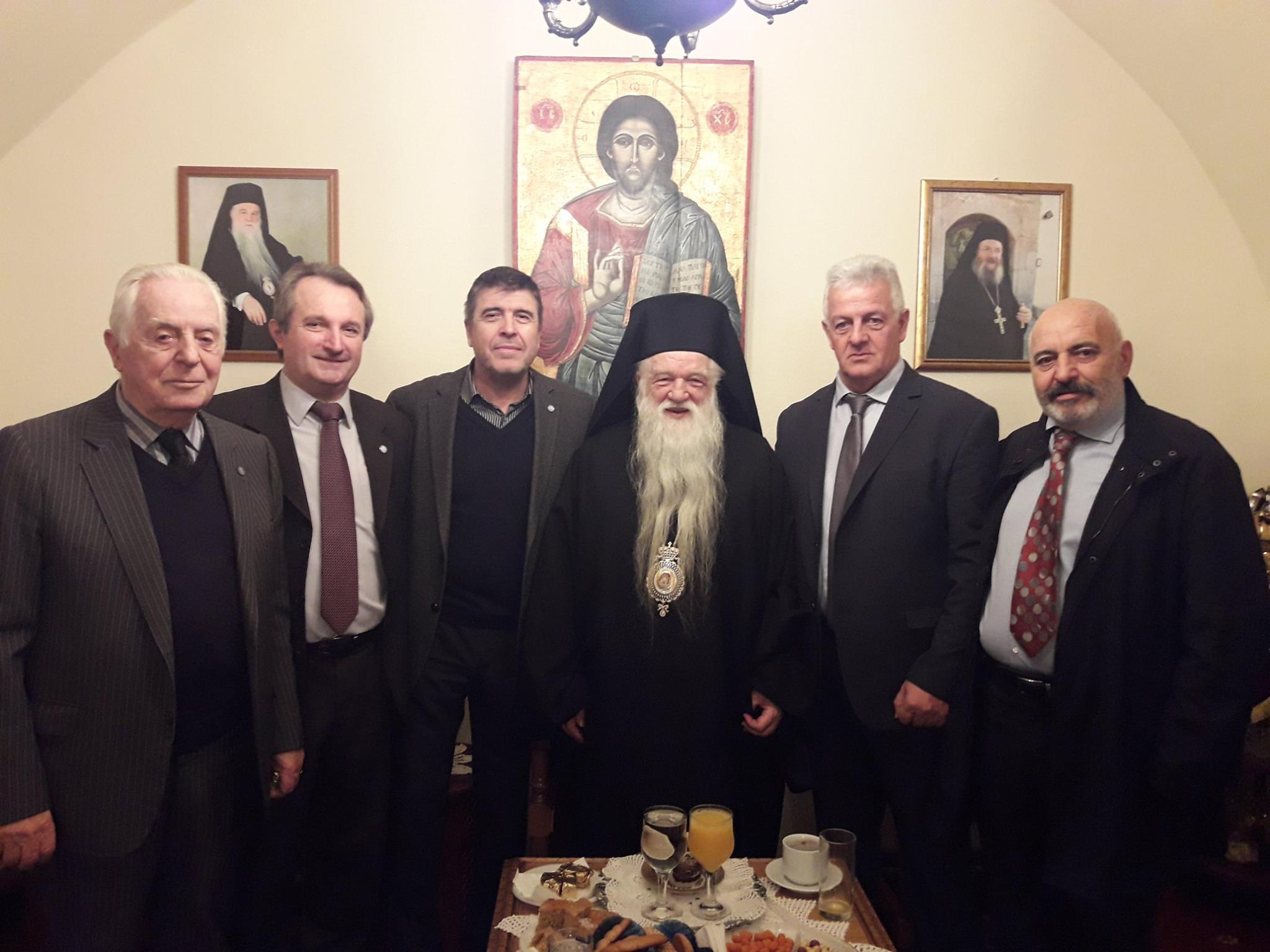Bishop Amvrosios of Kalavryta (C) poses with followers.