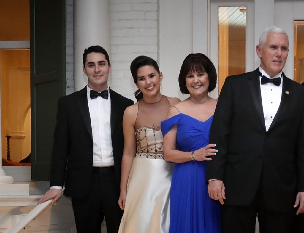 Vice President Mike Pence (C), his wife Karen Pence, their daughters Audrey (2nd L) and Charlotte (2nd R) and their son Michael and his wife Sarah pose for photographs on the front porch of the vice presidential residence at the U.S Naval Observatory before heading to the inaugural balls January 20, 2017 in Washington, DC.