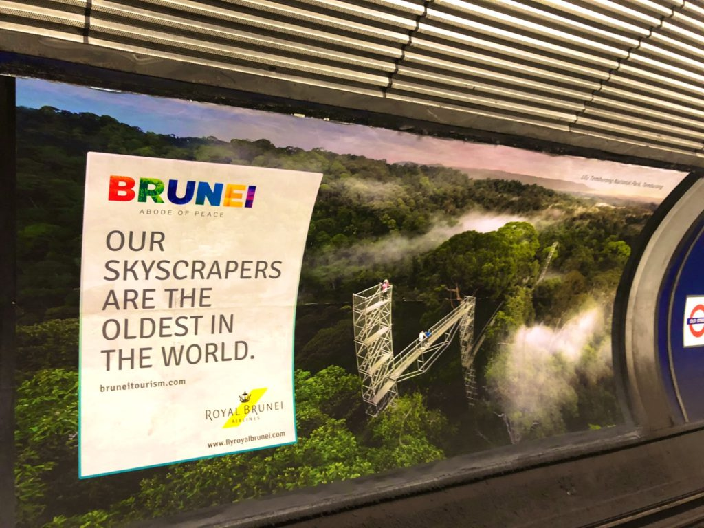An advert for Royal Brunei Airlines at a London tube station