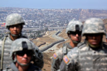 National Guardsmen stand in formation along the U.S.-Mexico border during a visit by California Gov. Arnold Schwarzenegger August 18, 2010 in San Ysidro, California.