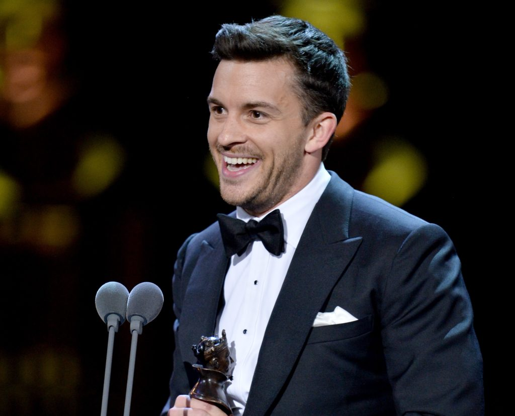 Jonny Bailey, winner of the Best Actor In A Supporting Role In A Musical award for 'Company', on stage during The Olivier Awards 2019 with Mastercard at the Royal Albert Hall on April 07, 2019 in London, England.