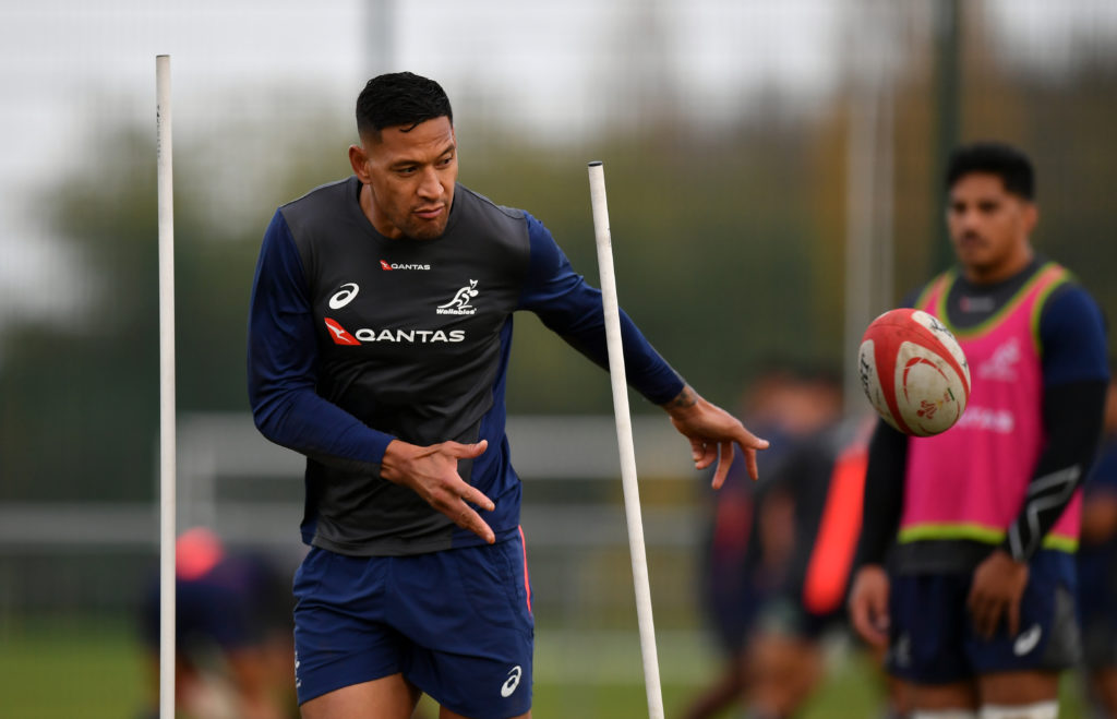 Israel Folau of Australia offloads during a training session.