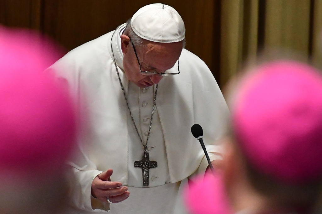 Pope Francis prays during the opening of summit on clerical sex abuse.