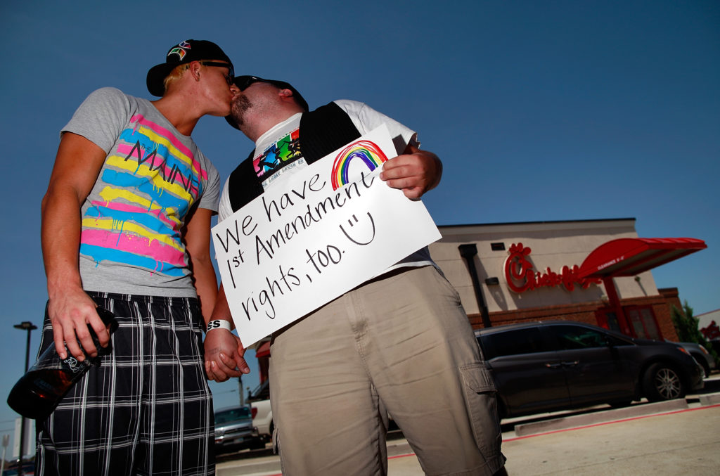 Same sex couple Tyler Savage and Larry Farris kiss outside a Chick-fil-A restaurant on August 3, 2012 in Dallas, Texas.