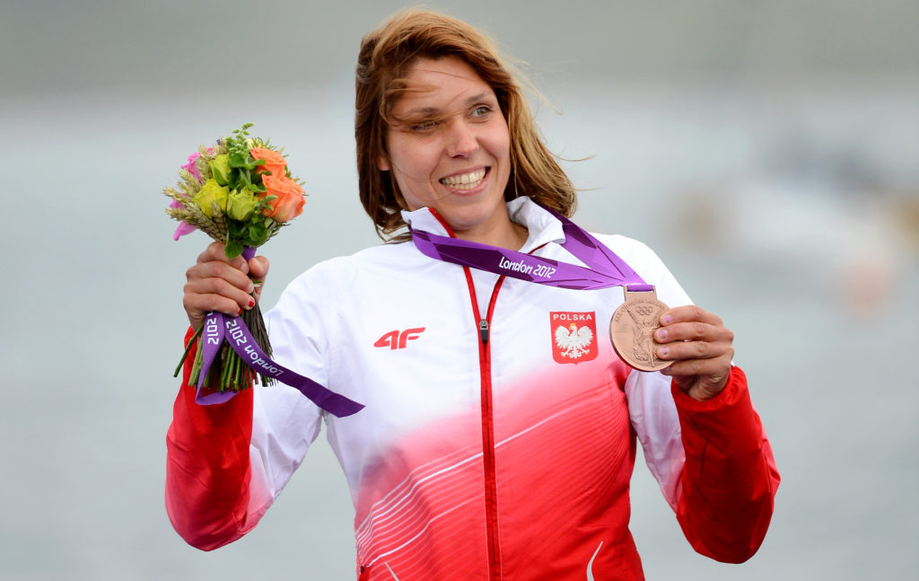 Poland's Zofia Klepacka celebrates her bronze medal on the podium.