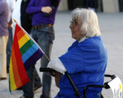 Older LGBT people like this woman holding a gay pride flag at a same-sex marriage victory celebration remain to be met.