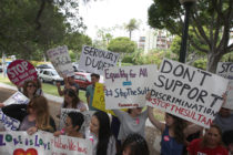 Demonstrators protest the punishment of women and LGBT people announced by the Sultan of Brunei near the Beverly Hills Hotel, which is owned by the Sultan, in Beverly Hills, California