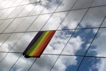 A rainbow flag is displayed on the building of European Council Office.