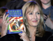 JK Rowling holds Harry Potter book