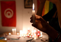 LGBT+ activists, who have protested the sentencing of a Tunisian man who reported a rape and a robbery for gay sex, commemorate the Pulse massacre.