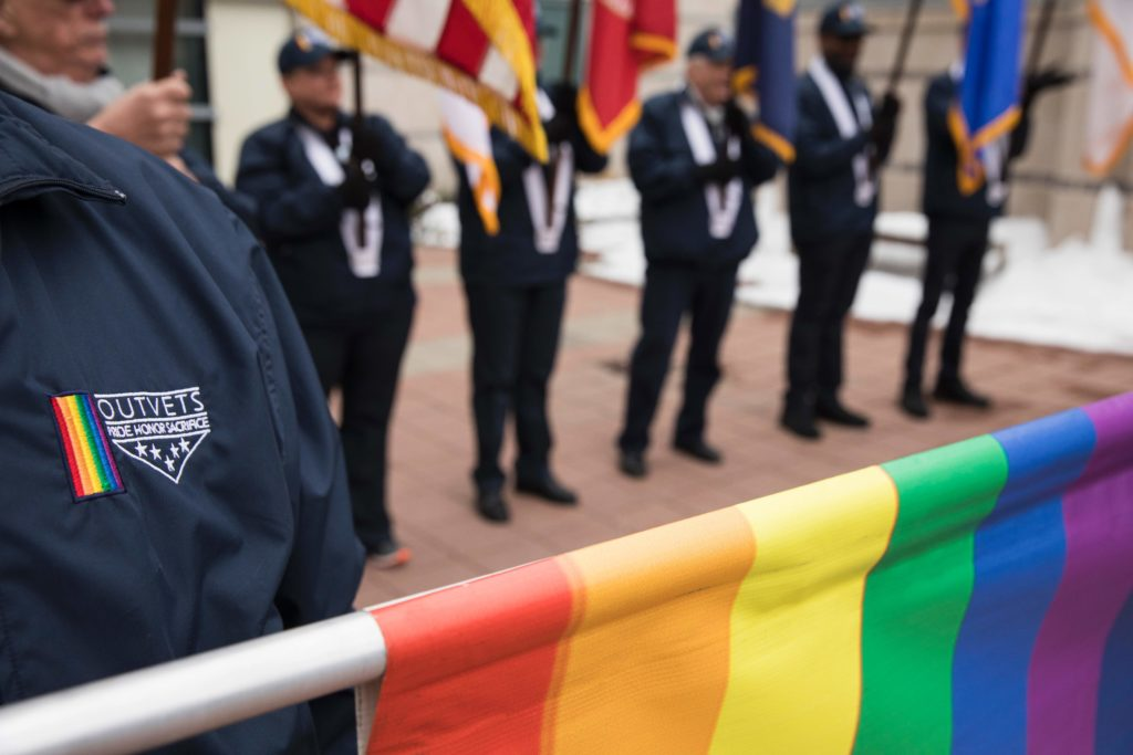 Bisexual veterans are among Marchers representing OutVets, a group for LGBTQ veterans.