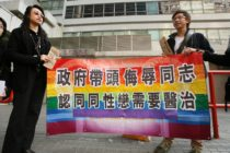 "Hong Kong, CHINA: A gay and homosexual group lead a protest to government offices in Hong Kong 01 December 2006. The group were urging the government to end discrimination to homosexuals with regard to an organisation which promotes conversion therapy for homosexuals. Banner reads"" Government leads campaign to insult gays and believes they need a cure"" AFP PHOTO/MIKE CLARKE (Photo credit should read MIKE CLARKE/AFP/Getty Images)"