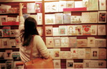 Cards buyer looks over Mother's Day cards.