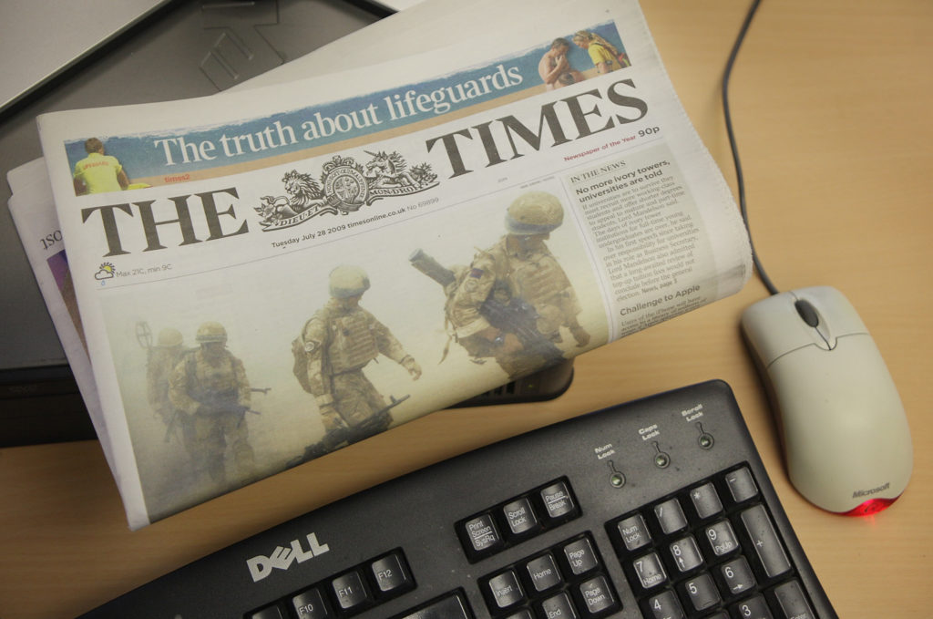 In this photo illustration a copy of The Times newspaper rests on a computer on August 7, 2009 in London.