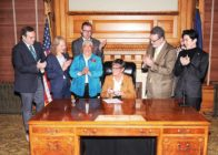 Governor of Kansas Laura Kelly signs an executive order protecting LGBT+ state employees from discrimination