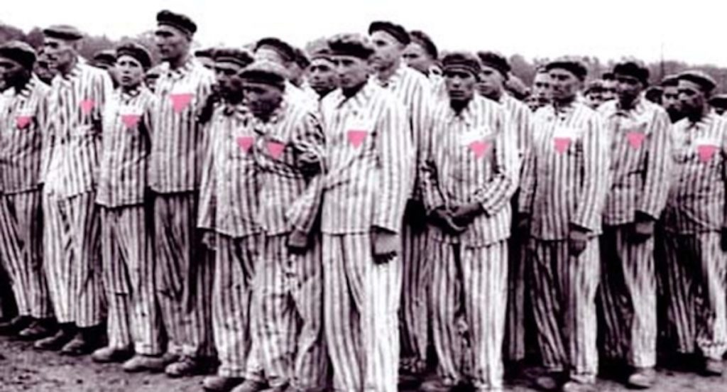 Gay men wearing pink triangle, representing Holocaust Memorial Day