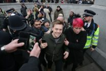 Guardian journalist Owen Jones is confronted by protesters in central London