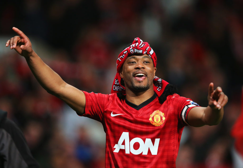 Patrice Evra of Manchester United celebrates victory and winning the Premier League title after the Barclays Premier League match between Manchester United and Aston Villa at Old Trafford on April 22, 2013 in Manchester, England.