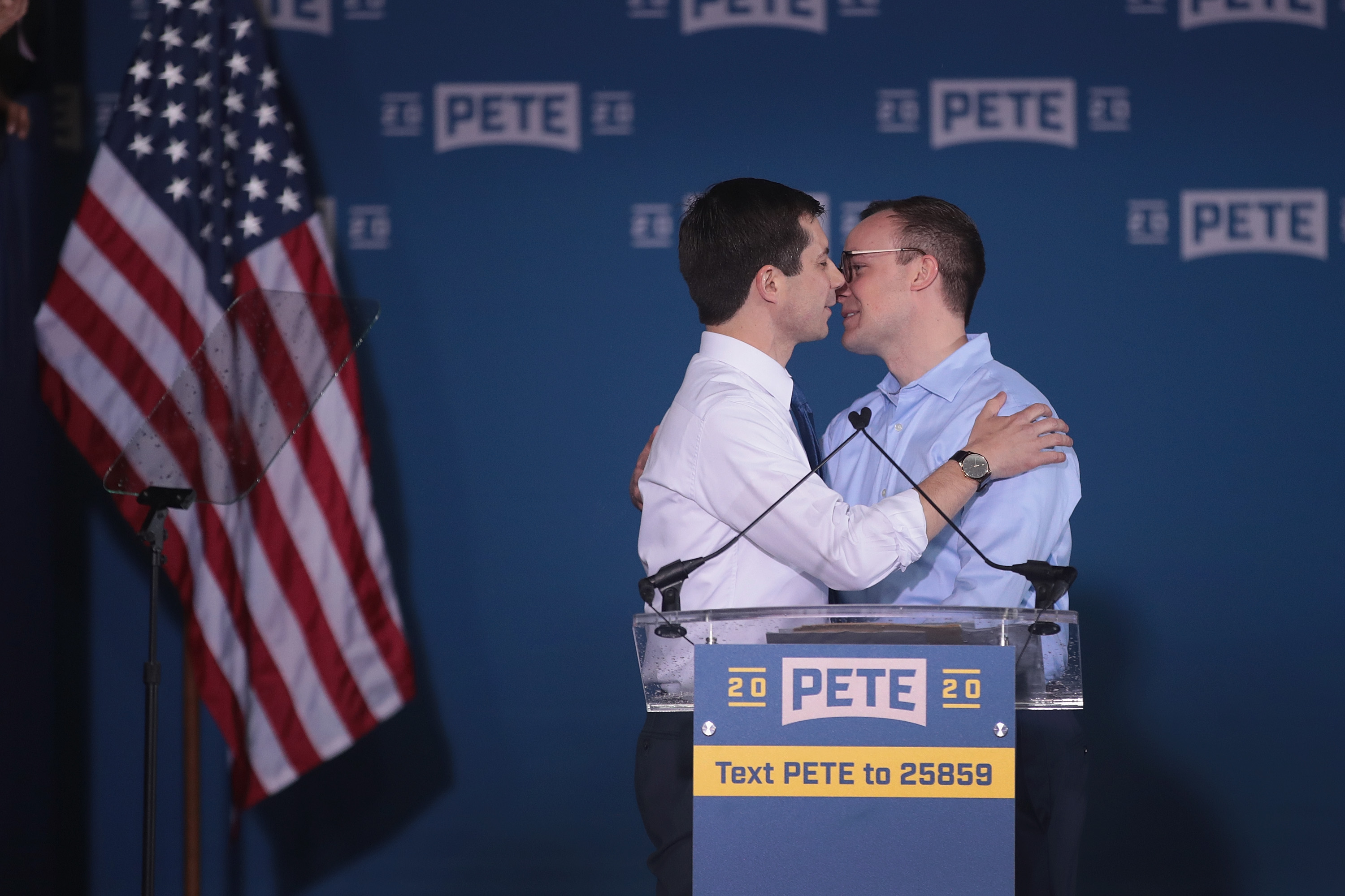 South Bend Mayor Pete Buttigieg greets his husband Chasten Glezman (R) after announcing that he will be seeking the Democratic nomination for president during a rally in the old Studebaker car factory on April 14, 2019 in South Bend, Indiana.