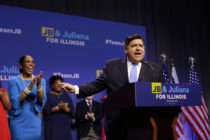 Illinois Democratic candidate for Governor J.B. Pritzker and his Lieutenant Governor pick Juliana Stratton arrive during his primary election night victory speech on March 20, 2018 in Chicago, Illinois.