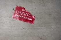 A 'Make America Great Again; sign sits on the floor following a Republicans rally on October 24, 2018.