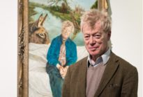 Tory housing tsar Sir Roger Scruton poses next to his portrai