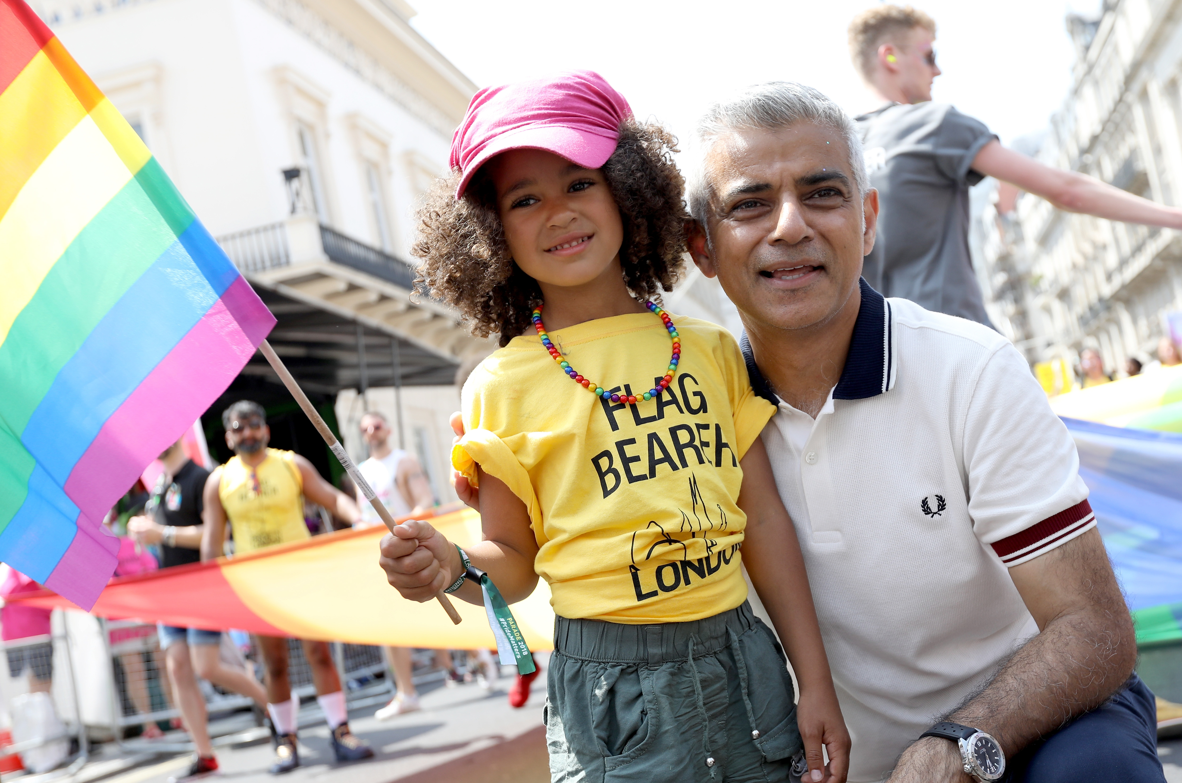 Mayor of London Sadiq Khan with a young flag bearer during the Pride In London parade on July 7, 2018 in London, England.