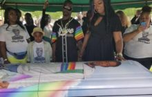 Nigel Shelby buried in rainbow casket.