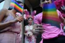 Participants wave rainbow flags during an LGBT+ rights rally in Bangkok, Thailand