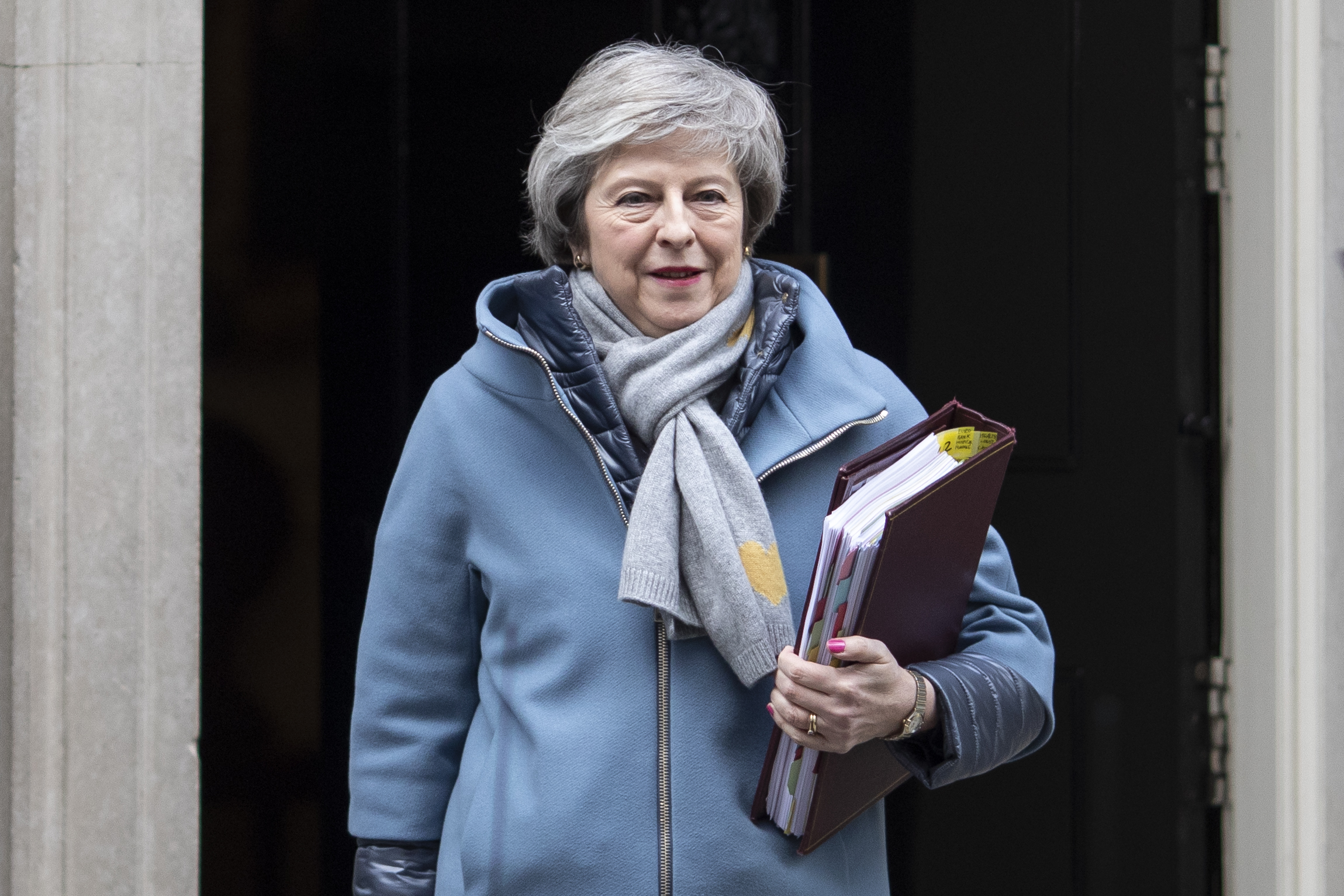 British Prime Minister Theresa May leaves 10 Downing Street to attend the weekly Prime Ministers Questions on January 9, 2019 in London, England.