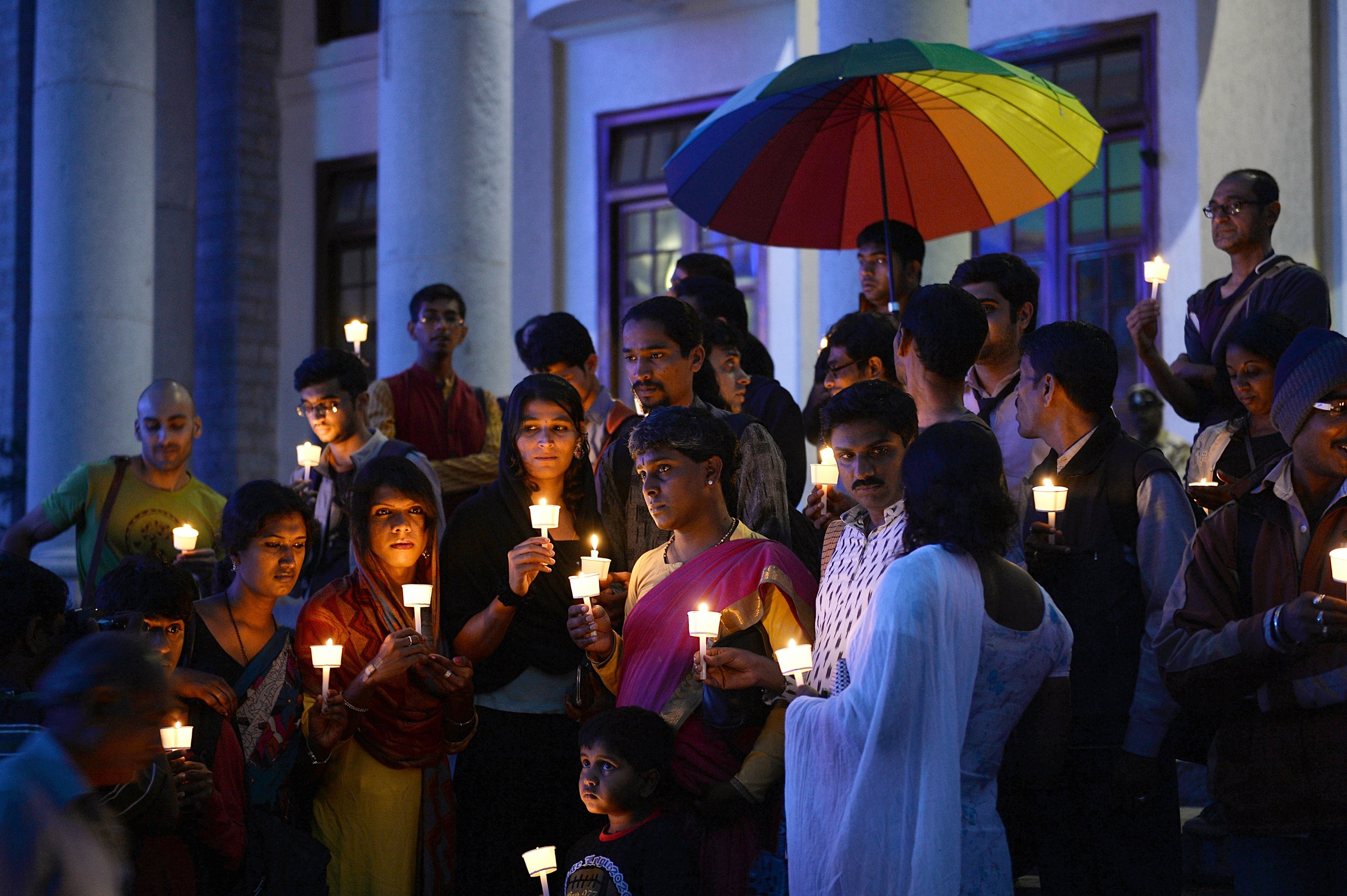 Transgender activists and their supporters take part in a candle light vigil.