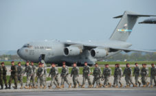 Members of the U.S. Army 173rd Airborne Brigade disembark upon their arrival by plane at a Polish air force base on April 23, 2014 in Swidwin, Poland.