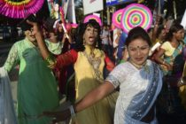 Hijras dance in the street