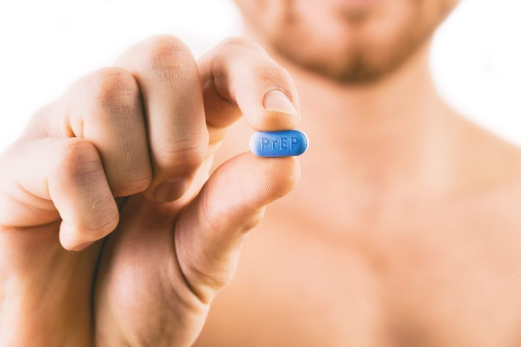 PrEP Impact trial: Man holding a pill used for Pre-Exposure Prophylaxis (PrEP) to prevent HIV infection