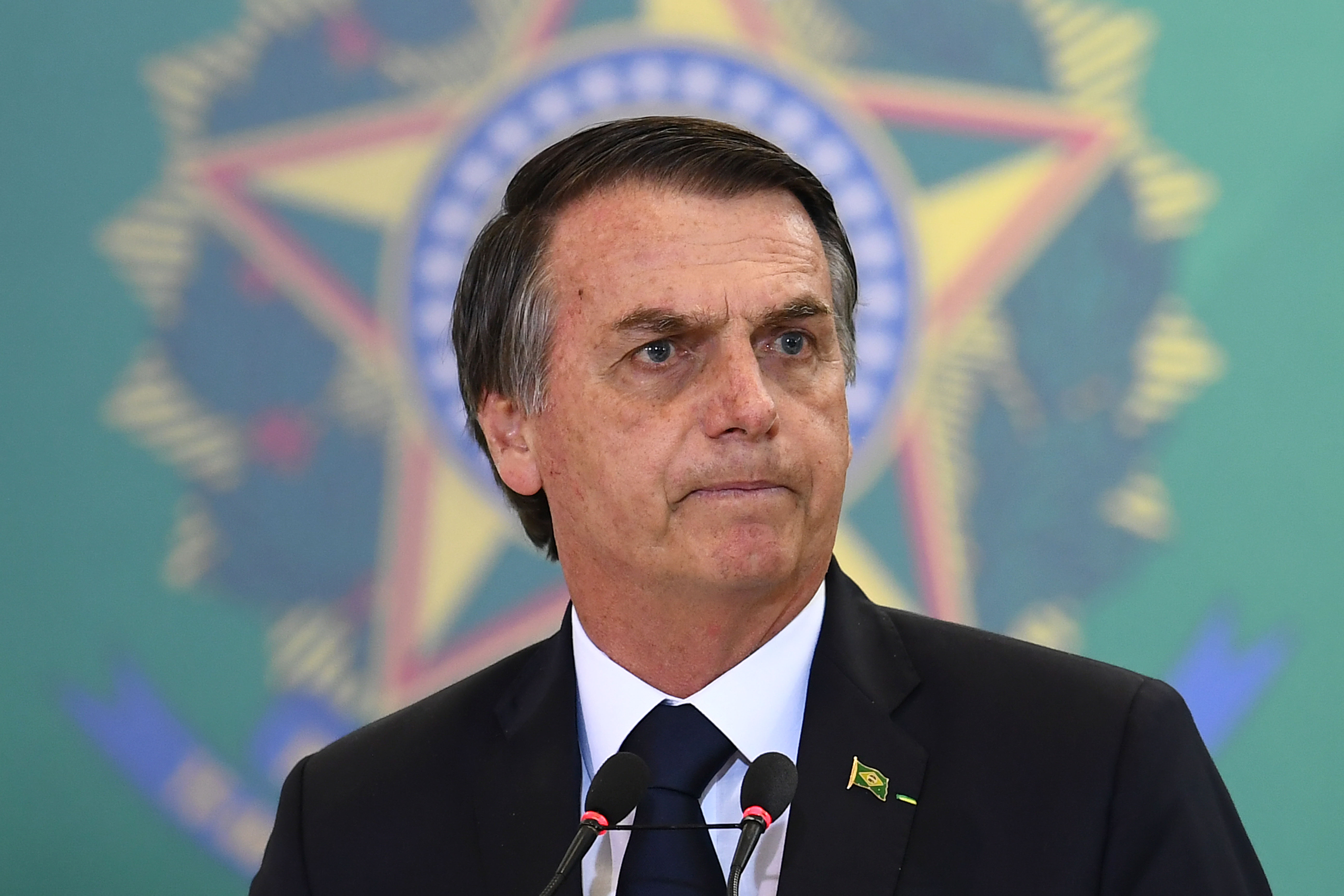Brazilian President Jair Bolsonaro delivers a speech during the appointment ceremony of the new heads of public banks, at Planalto Palace in Brasilia on January 7, 2019