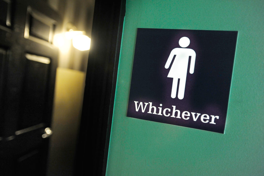 A gender neutral bathroom sign in the US.