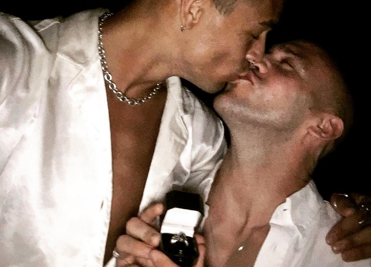 Hollyoaks star Jimmy Essex and long-term partner Charles kiss