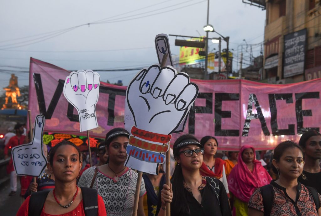 Women holding placards during a rally