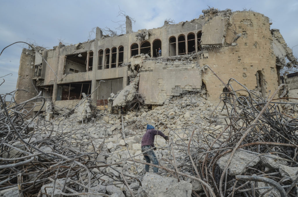 ISIS news: An Iraqi climbs up the rubble of the destroyed seven-storey Chadirji Building, designed by celebrated Iraqi architect Rifat Chadirji in the 1960s, on January 13, 2019, in the city of Mosul.