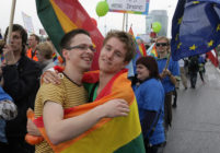 People pose as they took part in the ''Baltic Pride 2010'' march, the first gay pride event in Lithuania, on May 8, 2010