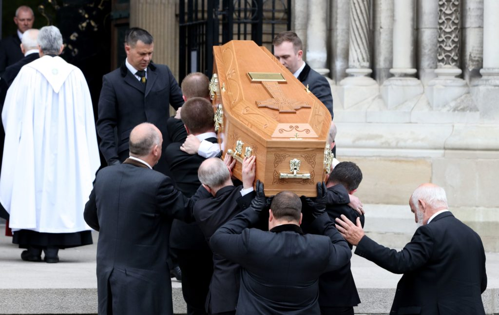 Pallbearers carry the coffin of journalist Lyra McKee
