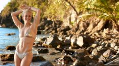 Megan Rapinoe poses on a beach in St. Lucia for Sports Illustrated Swimsuit