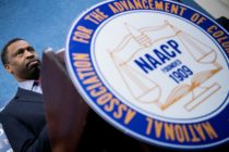 Derrick Johnson, President and CEO of the NAACP, pauses while speaking during a press conference announcing a lawsuit by the NAACP
