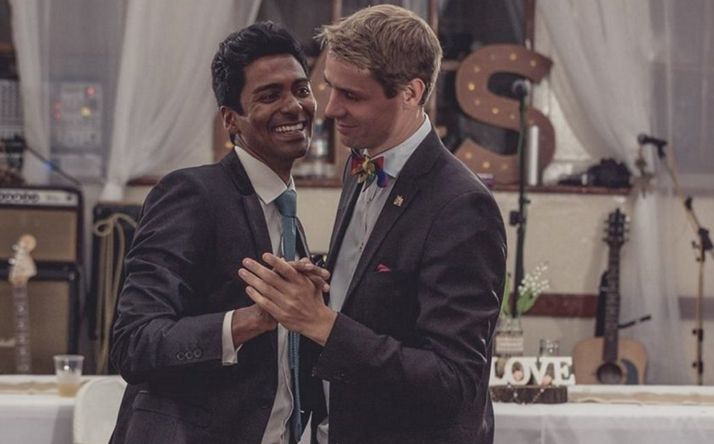 The grooms in Saint Helena's first gay wedding, Michael Wernstedt and Lemarc Thomas, dance in suits