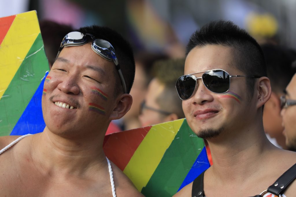 Participants pose at the square outside the presidential office before the start of a gay pride parade in Taipei, Taiwan on October 27, 2018.