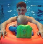 Tom Daley and Dustin Lance Black take son for first swim