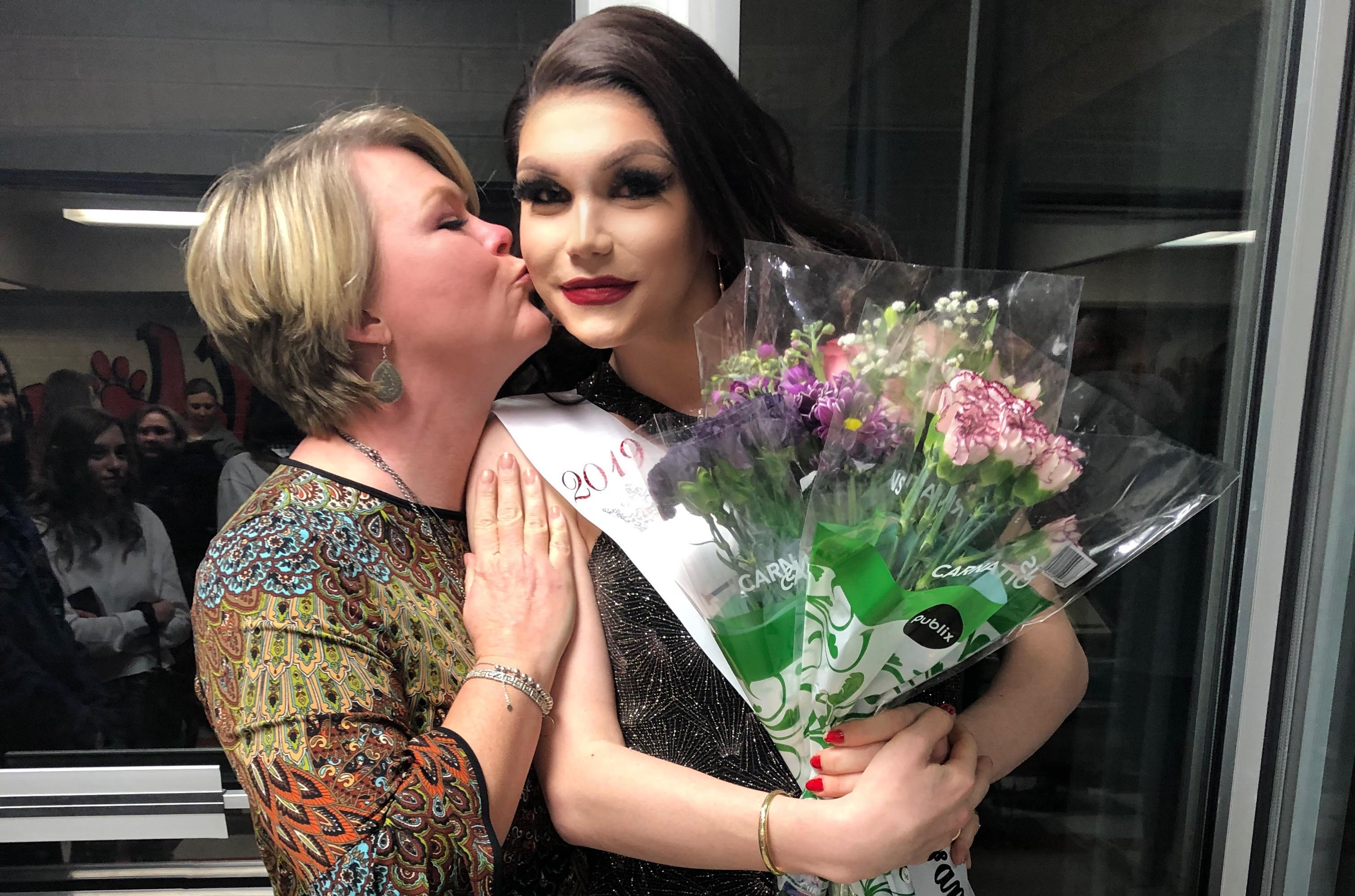 Trans teen Charlie Baum with her mother on the night she became homecoming queen