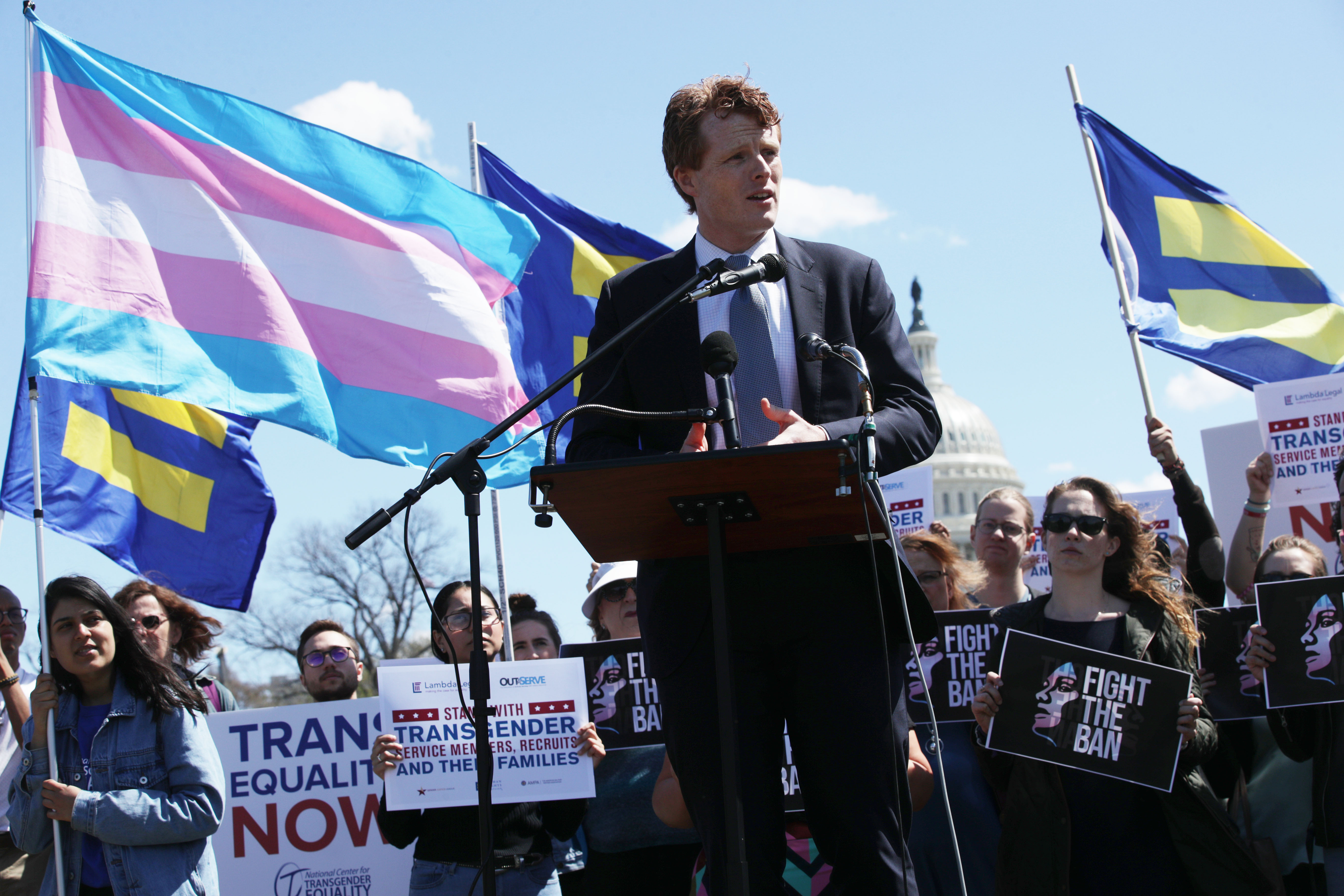 Joe Kennedy at a rally with the White House just behind