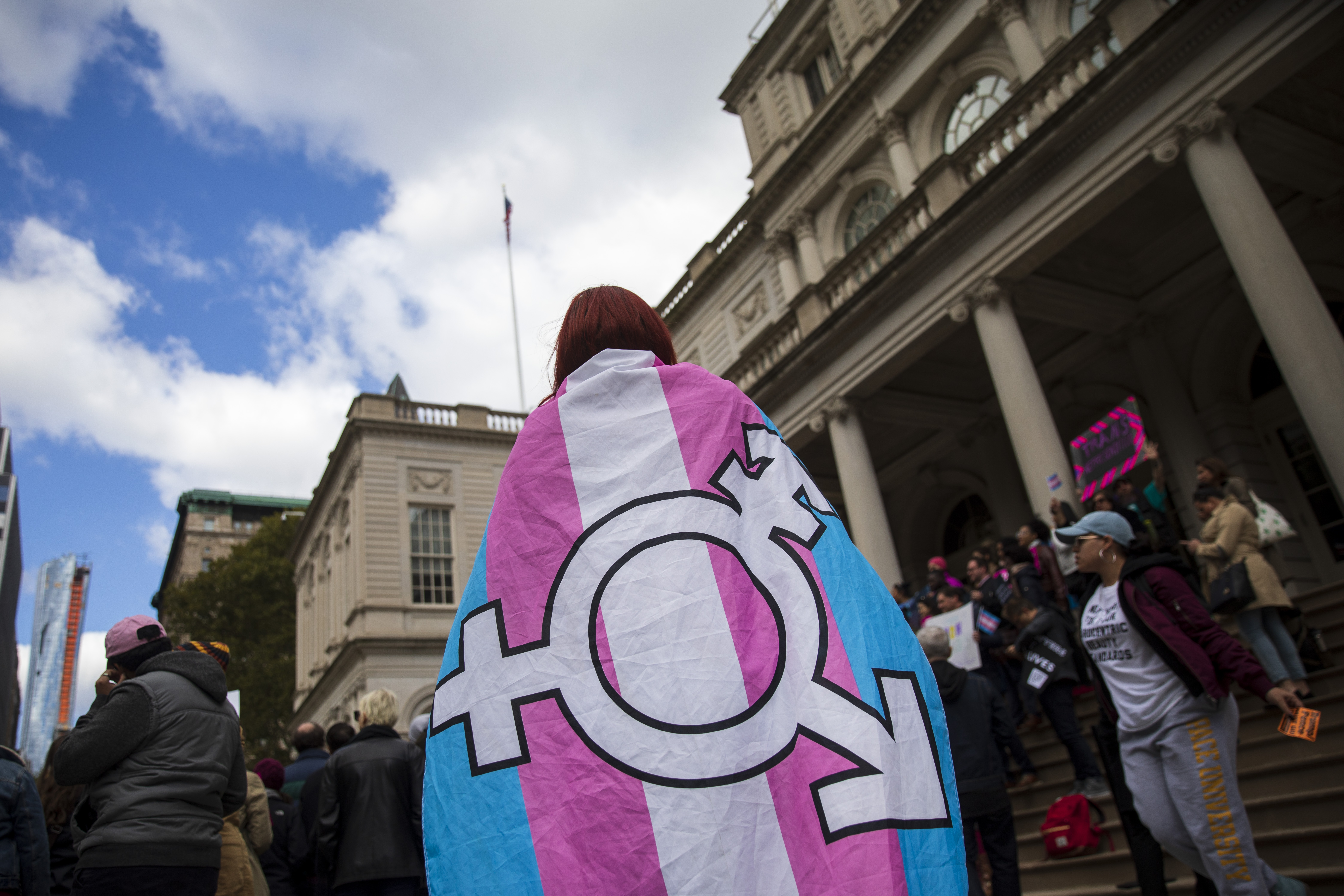 Photo of person adorned in trans flag crime england wales