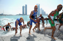 The Elite Men leave the water during the 2016 ITU World Triathlon Abu Dhabi on March 5, 2016 in Abu Dhabi, United Arab Emirates.